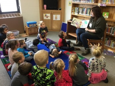 Library staff member reading to children during story time