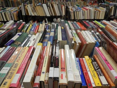 Stacks of books for sale at the library