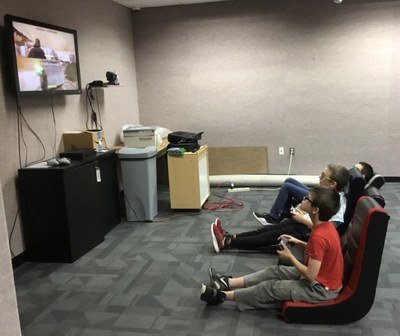 Tweens playing video games at the library