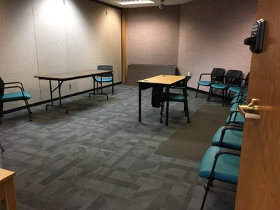 View inside the Multi-Purpose Room meeting room, with chairs and tables.