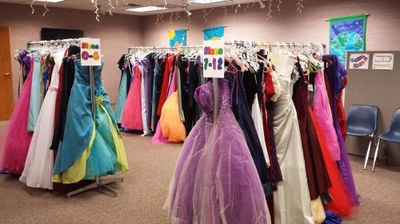 Racks of prom dresses at the library